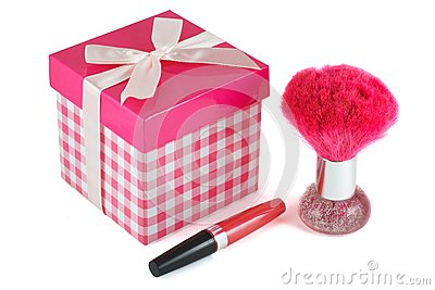 Lip gloss, a brush for powder
