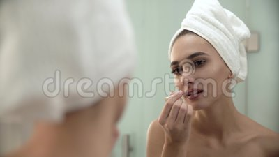 Lips Makeup. Woman Using Liquid Lipstick At Bathroom. Young Beautiful Female Looking in Mirror And Making Makeup After Shower stock video
