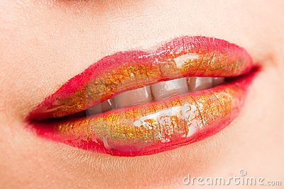 Lips with red, green and yellow lipstick