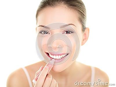 Lipstick makeup woman putting lip balm care beauty