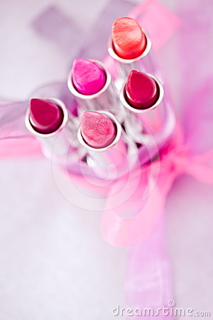 Lipsticks and lipglosses with bow