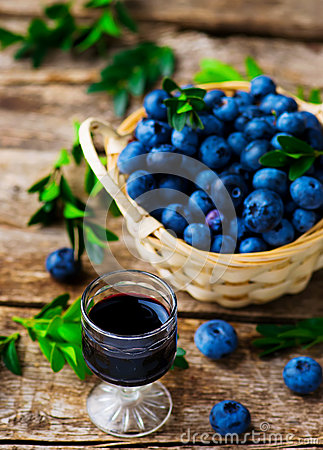 Free Liqueur From Blueberry In A Shot Glass Royalty Free Stock Images - 58460799