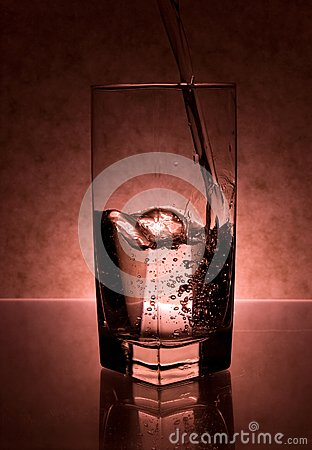 Liquid Being Poured into Glass