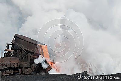 The liquid molten slag and a cloud of hot steam