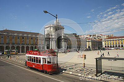 Red sightseeing tram at Lisbon Commerce square Editorial Stock Image