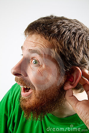 Listen - funny curious man with hand at ear