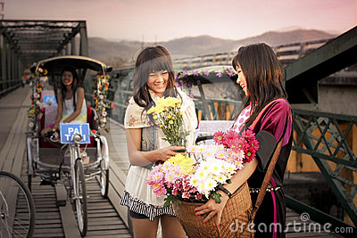 Lisu Hill tribe flower street vender and  tourist Editorial Stock Image