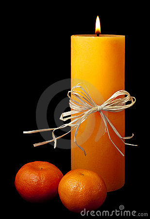 Free Lit Candle With Two Clementines Isolated On Black Royalty Free Stock Photos - 12476698