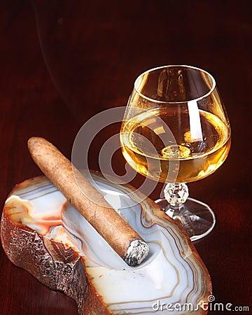Lit cigar and after dinner liquor