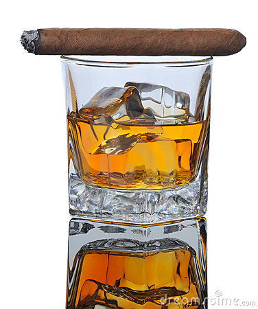 Lit Cigar on Whiskey Glass