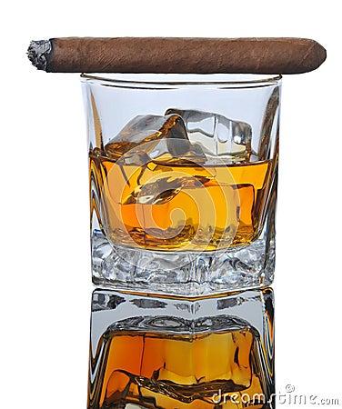 Lit Cigar on Whiskey Glass