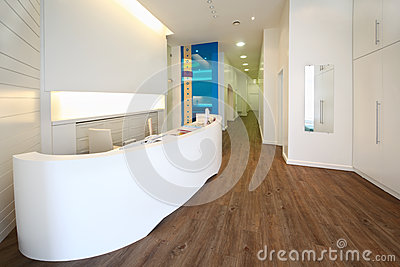 Lit reception area in dental clinic.