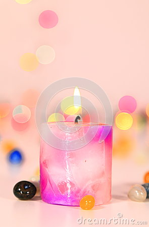 A Lit-up Candle with bokeh background
