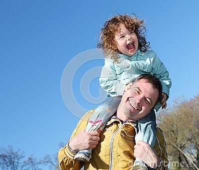 Litlle girl with father in the park