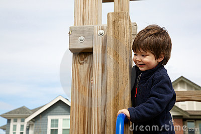 Litte boy playing on playground