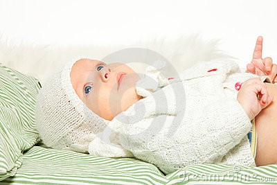 Little adorable baby in the bed
