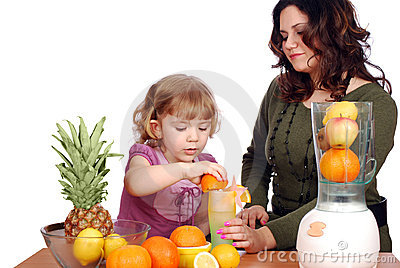 Little and adult girl made fruit juice