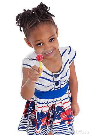 Little african american girl with a lollipop