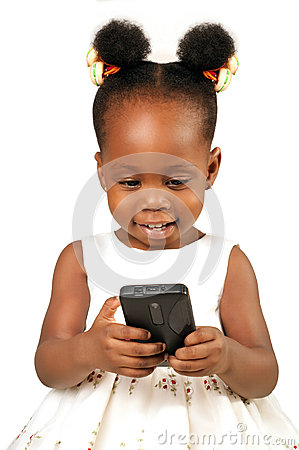 Little girl smiling at a mobile  phone