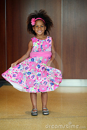Little african-american girl modeling on runway