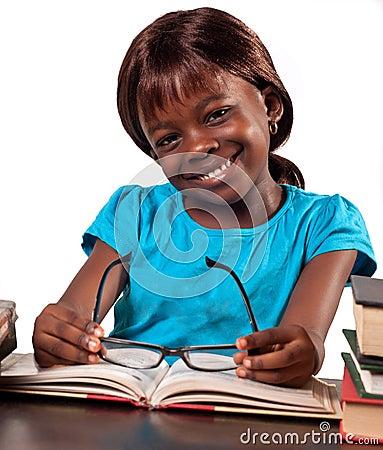 Smiling schoolgirl studying