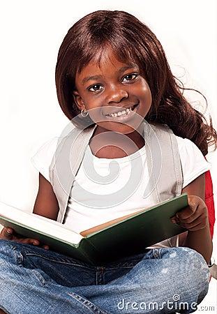 School child girl reading book.