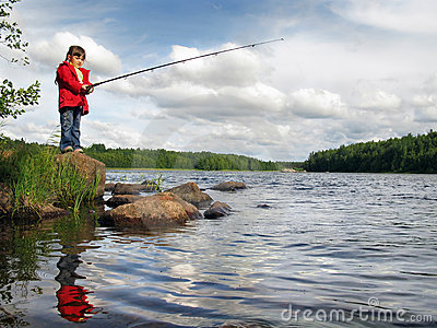 Little angler girl fishing on lake with rod