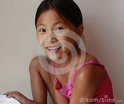 Little Asian Chinese girl holding toy