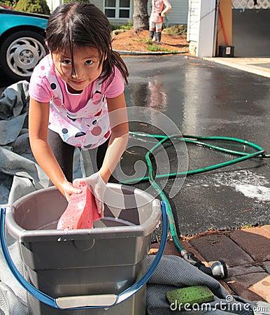 Little asian girl with bucket