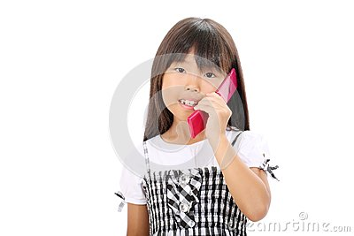 Little asian girl calling by phone