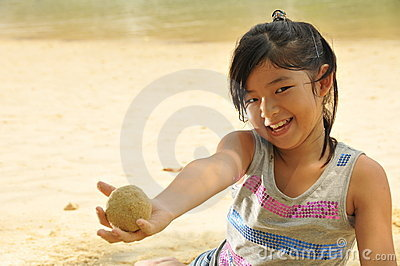 Little Asian Girl Having Fun By The Beach