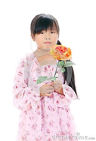 Little asian girl holding a rose