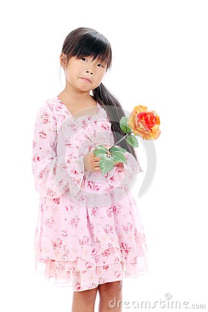 Little asian girl holding a rose
