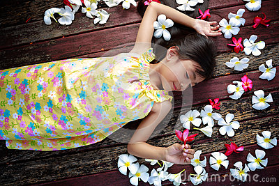 Little asian girl laying on the floor