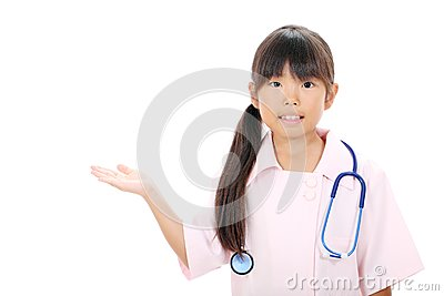 Little asian girl in a nurse uniform