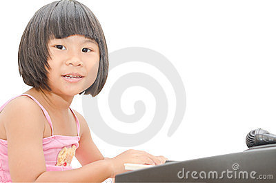 Little Asian girl play on digital piano