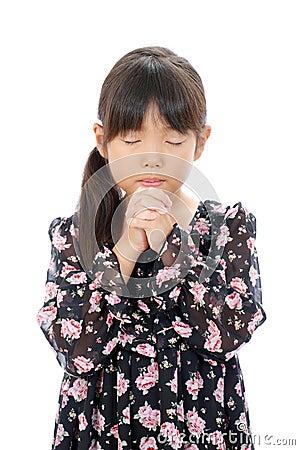 Little asian girl praying