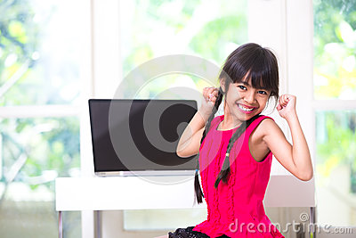 Little asian girl stretching her arms