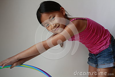 Little Asian girl with hula hoop
