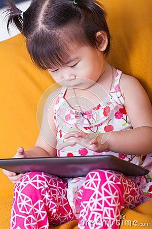 Free Little Asian Girl Using Digital Tablet, Child Finger Point At Co Stock Images - 52221004