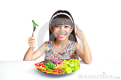 Little asian girl with vegetables food
