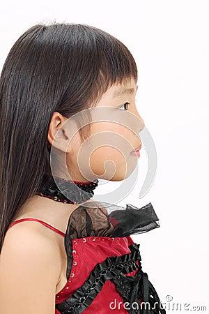 Little asian girl wearing dress