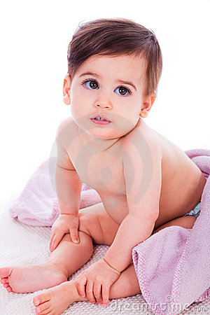 Little baby bending down and covered with towel