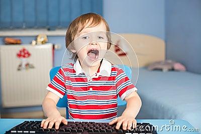 Little baby boy screaming when typing on keyboard