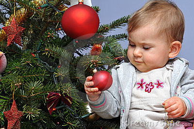 Little baby and Christmas tree