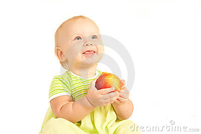 Little baby eat red peach smiling