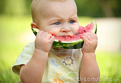Little baby eating watermelon