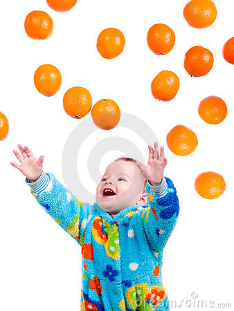 Little baby girl caughts flying oranges