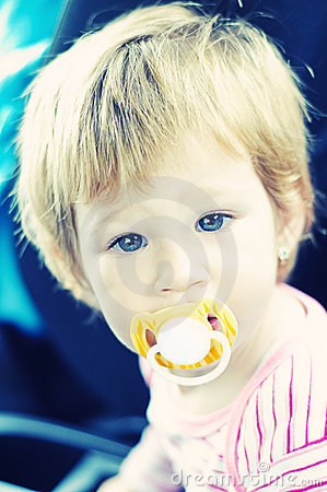 Little baby girl with pacifier