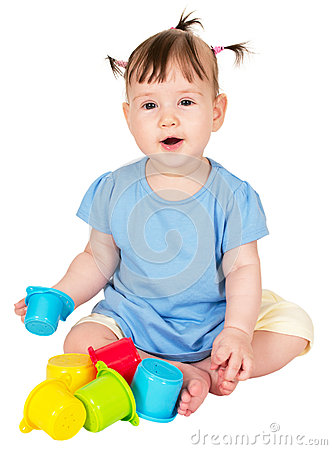 Little baby girl playing with childs toy stacking